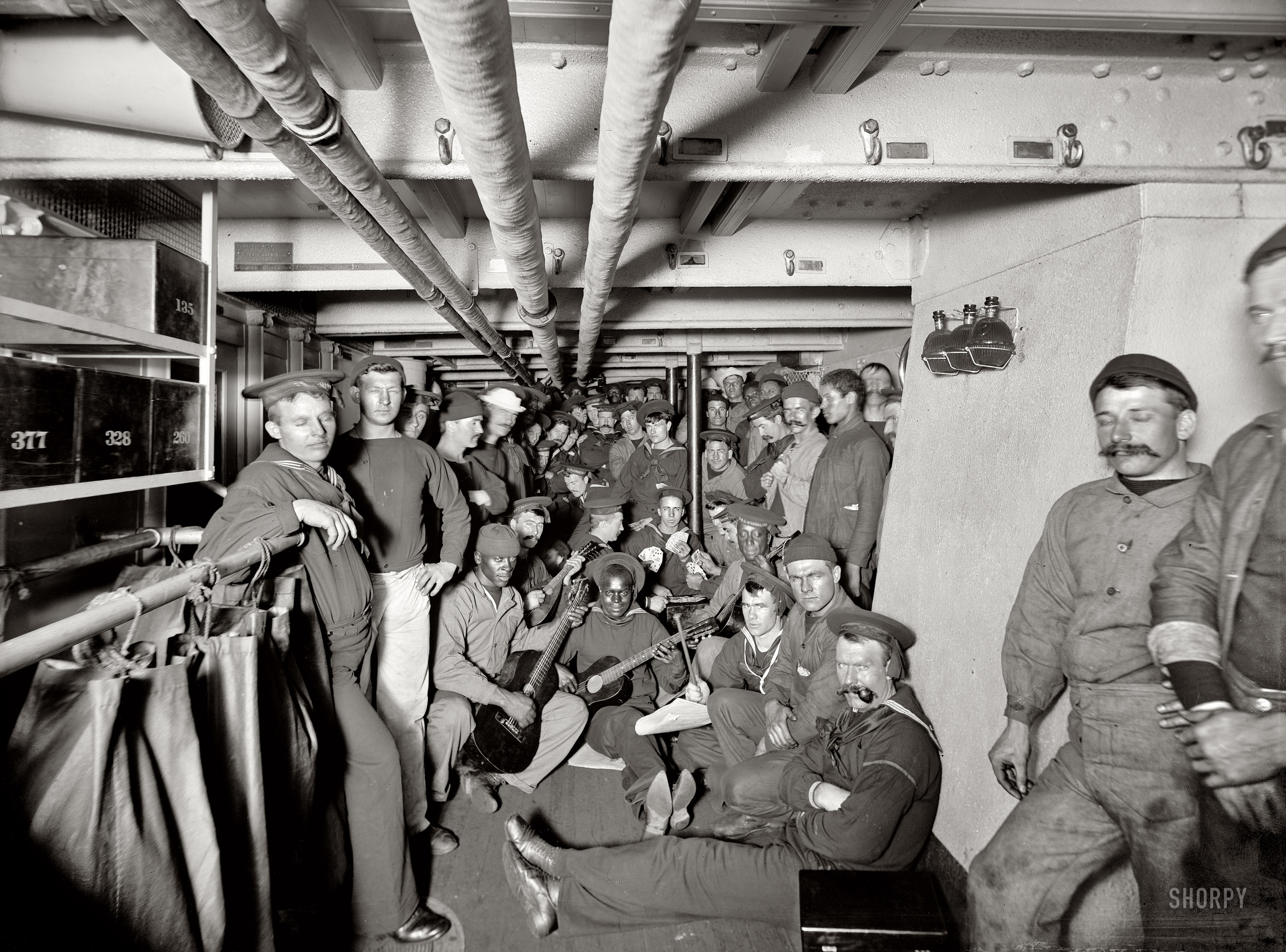 Below decks aboard the U.S.S. Brooklyn circa 1897. Glass negative by Edward  H. Hart, Detroit Publishing Company. | Click image for Comments.