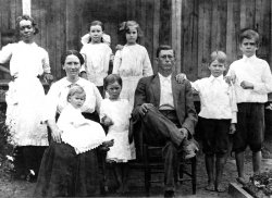 Father with family, c. 1910