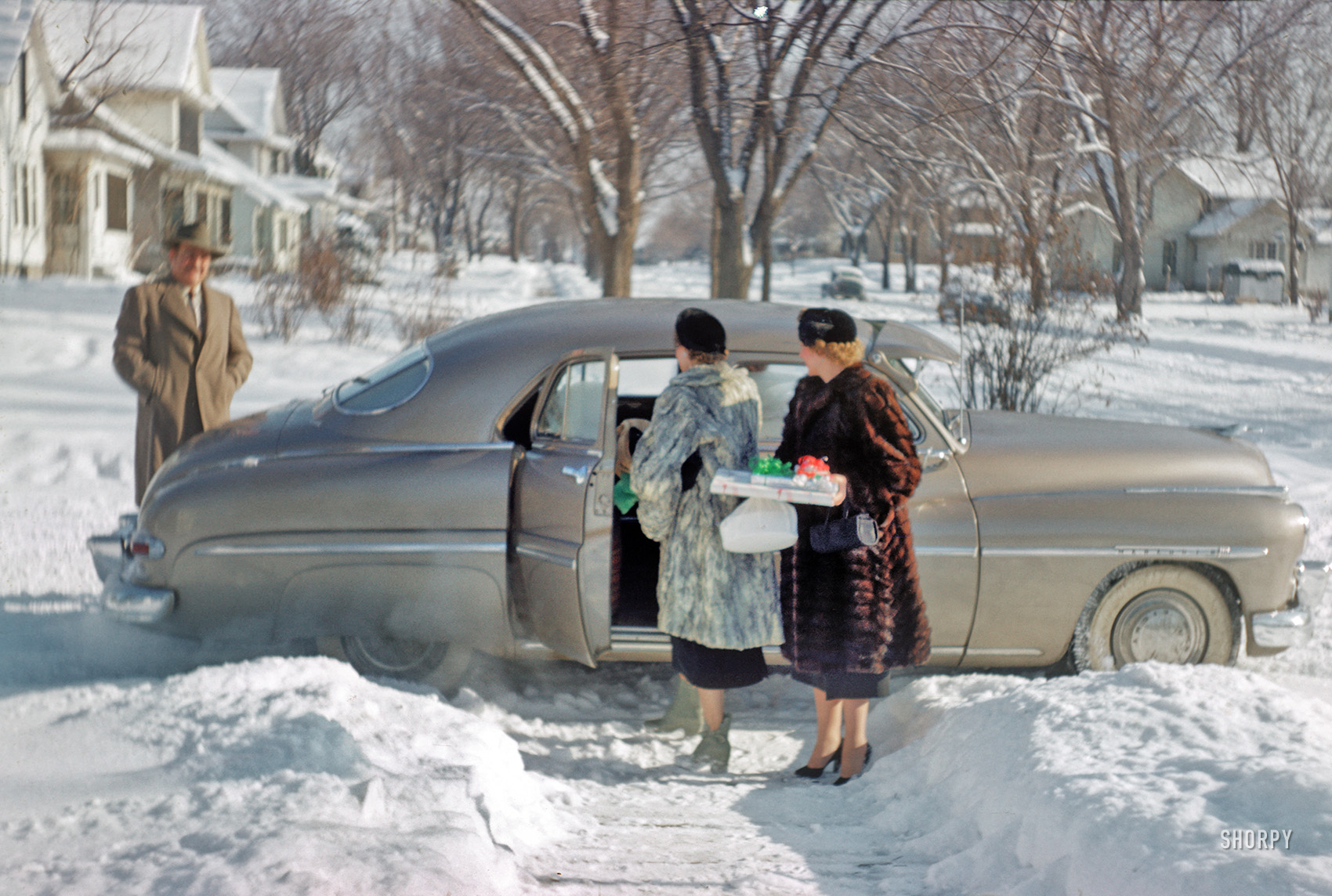 "25, 1951."" We return to fur-friendly Blue Earth, Minnesota, for a Christmas  visit from the folks last seen here last year. 35mm Kodachrome by Grace or  ..."
