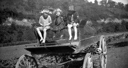 Three kids on a wagon, 1923